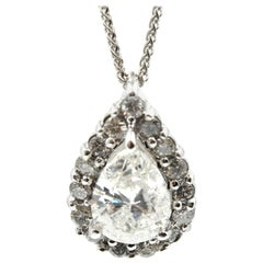 14 Karat White Gold, Pear Shaped Diamond with Diamond Halo Pendant Necklace