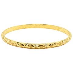 14 Karat Yellow Gold Bangle with Textured Design