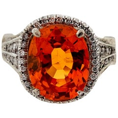 Platinum 5.52 Carat Spessartite Garnet and Diamond Halo Ring