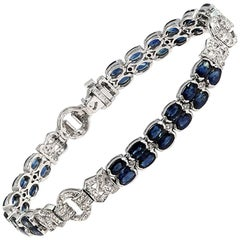 12.22 Carat Blue Sapphires 0.72 Carat Diamonds 18 Karat White Gold Bracelet