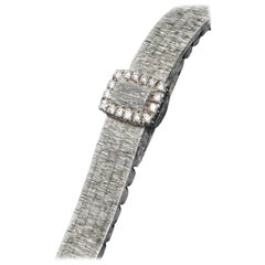 Piaget White Gold Diamond Concealed Dial Bracelet Wristwatch, circa 1960s