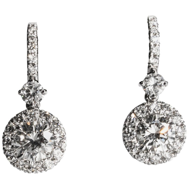 1.37 Carat Dangling Halo Diamond Earrings in 18 Karat White Gold