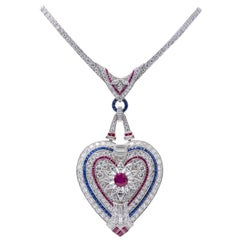 Important Platinum Diamond Ruby and Sapphire Heart Pendant Necklace