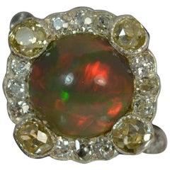 Stunning Black Opal 1.20 Carat Old Cut Diamond 18 Carat Gold Cluster Ring