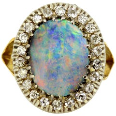 Art Deco 18 Karat Gold Dome Ring with Black Opal and Diamonds, circa 1920s