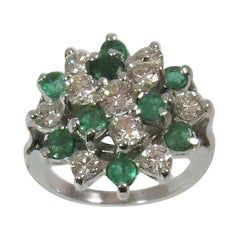 14 Karat White Gold Ring with Round Faceted Emeralds and Round Diamonds