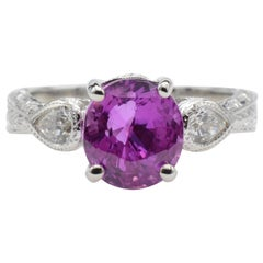 Oval Pink Sapphire Engagement Ring with Pear Diamonds and White Gold Filigree