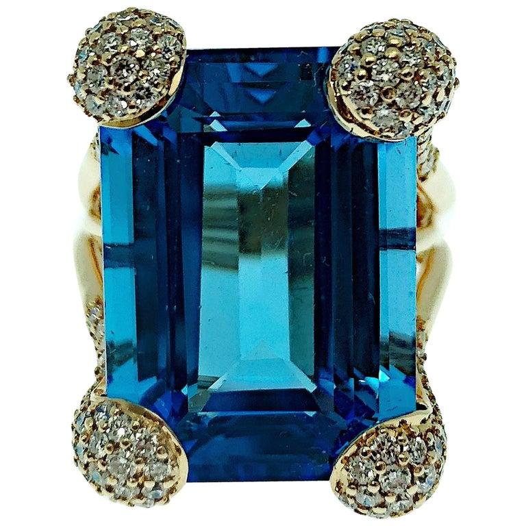 18 Karat Rose Gold 19 Carat Blue Topaz and Diamonds Ring