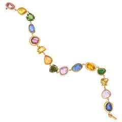 18KT Gold Bracelet with diamonds, tsavorites and blue, pink and yellow sapphires