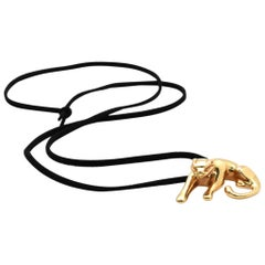 14 Karat Yellow Gold Panther Pendant on Black Silk Cord