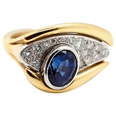 18 Karat Yellow Gold, 1.15 Carat Diamond and 1.00 Carat Sapphire Eye Ring