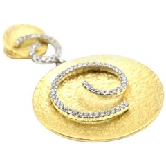 0.22 Carat Diamond 18 Karat White and Yellow Gold Swirl Pendant