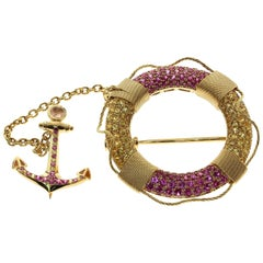 Yellow and Pink Sapphire 18 Karat Yellow Gold Lifebuoy and Anchor Brooch