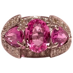 Spectacular Vivid Pink Sapphire Diamond Platinum Engagement or Three-Stone Ring