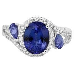 Tanzanite Oval Diamond Three-Stone Gold Halo Ring