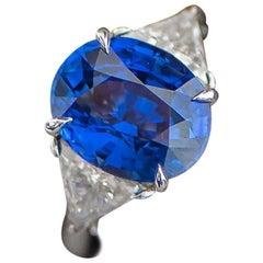 Platinum, Diamond and 5.51 Carat Oval Ceylon Blue Sapphire Cocktail Ring