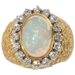 Ring with Crystal Opal Cabochon and Diamonds, 14 Karat Gold