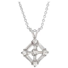 0.69 Carat Round and Baguette Diamonds in 14 Karat Gold Flower Necklace