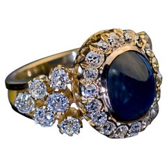 Antique 5.37 Carat Cabochon Sapphire 2.60 Carat Diamond Gold Cluster Ring