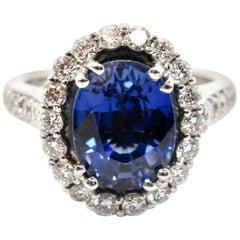 14 Karat White Gold, 5.31 Carat Oval Sapphire and 1.26 Carat Diamond Halo Ring
