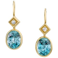 6.68 Carat Blue Zircon with .08 Carat Diamonds 18 Karat Yellow Gold Earrings
