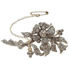 Early 20th Century 9 Karat Gold, Silver and 2.36 Carat Diamond Foliate Brooch