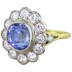 Art Deco 5.76 Carat Natural Ceylon Sapphire and Old Cut Diamond Cluster Ring