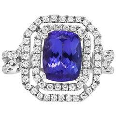 1.99 Carat Emerald Cut Tanzanite and 0.65 Carat White Diamond Ring