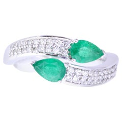 0.62 Carat Pear Shaped Emerald and White Diamond Wrap Ring
