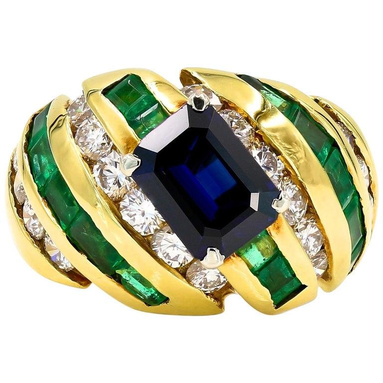 Emerald, Sapphire and Diamond Ring in 18 Karat Yellow Gold