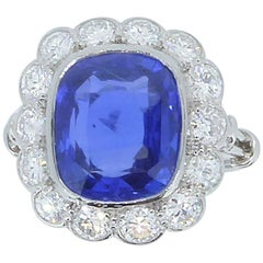 8.43 Carat Unheated Ceylon Sapphire Diamond and Platinum Cluster Ring