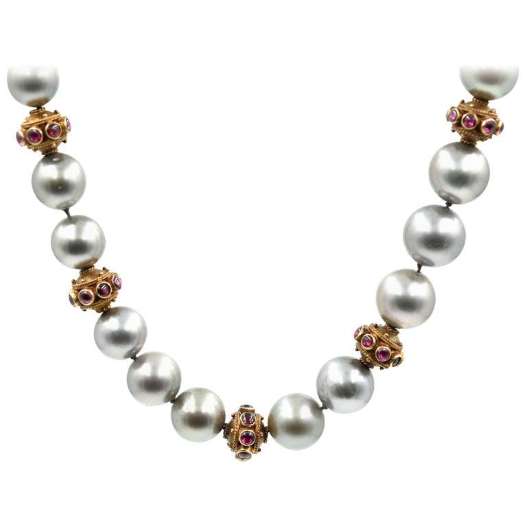 Strand of Black Tahitian South Sea Pearls 14 Karat Yellow Gold Cabochon Rubies