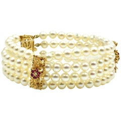 Pearl Strand Bracelet with 14 Karat Yellow Gold Ruby Stations