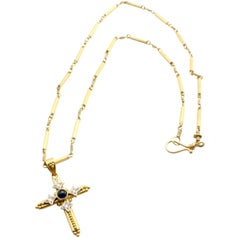 22 Karat Yellow Gold Cross Necklace with Sapphire Cabochon