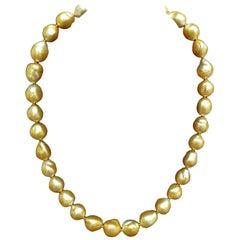 18 Karat Natural South Sea Golden Pearls Necklace 1.50 Carat Diamond Clasp