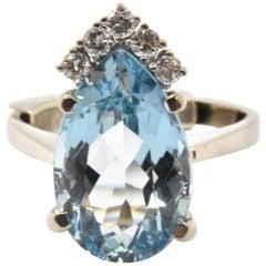 14 Karat White Gold Round 0.10 Carat Diamond and Pear Cut Blue Topaz Ring