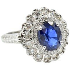 14k White Gold 2.95ct Oval Blue Sapphire, and 2.07cttw Round Diamond Halo Ring