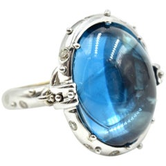 14 Karat Gold Cabochon Blue Topaz with Cognac and White Diamond Accents Ring