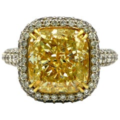 6.58 Carat EGL Fancy Light Yellow Cushion SI2 with Pave Diamonds Platinum Ring