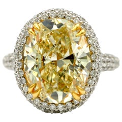 7.36 Carat EGL Fancy Light Yellow Oval SI2 with Pave Diamonds in 18 Karat Ring