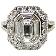 Estate Vintage 18 Karat White Gold Emerald Cut and Round Diamond Halo Ring