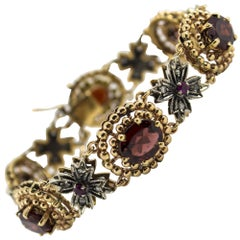 20.00 Carat Garnet 0.43 Carat Ruby 0.75 Carat White Diamond Yellow Gold Bracelet