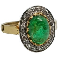 3.8 Carat Emerald 0.75 Carat Diamond Ring