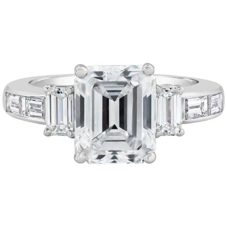 GIA Certified G-VS1, 3.36 Carat Emerald Cut Diamond Three-Stone Engagement Ring