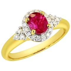 1.06 Carat Natural Ruby Halo Ring 23 Points VS/G Diamonds Set in 18 Karat Gold