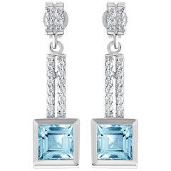 14 Karat Gold 2.70 Carat Natural Blue Topaz Drop Earrings with 32 VS Diamonds