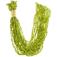 15 Strand Torsade Peridot Beads with 18 Karat Yellow Gold Clasp