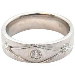 14 Karat White Gold Three Round Diamond Wedding Band