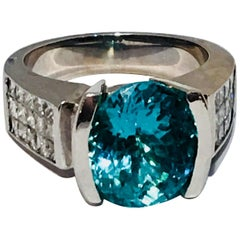 Large GIA Certified Oval Paraiba Tourmaline and Diamond 18 Karat White Gold Ring