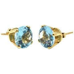 Round Brilliant Blue Topaz Stud Earrings 14 Karat Yellow Gold